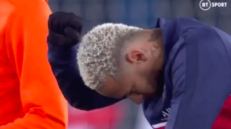PSG and Basaksehir players take a knee ahead of their delayed Champions League fixture