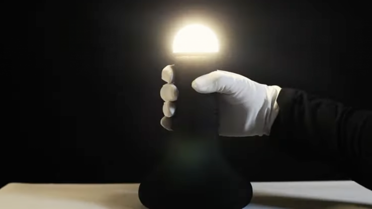 You turn on this lamp by peeling back it's rubber 'foreskin'