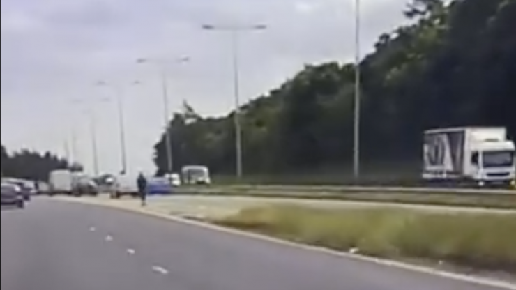 WATCH: Staggering moment police pull over man on e-scooter trying to join motorway