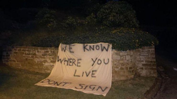 Threatening banner laid near Rafa Benitez's home as Everton rumours intensify