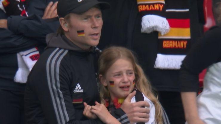 England fans heard cheering when crying German girl was shown on big screen