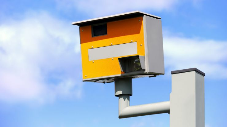 Man filmed climbing into speed camera and flashing drivers with phone