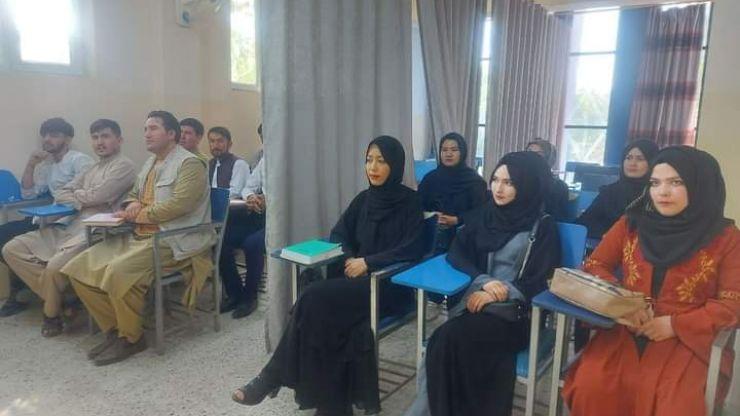 Taliban hides female students behind curtain as Afghan universities return