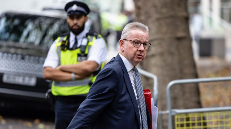Michael Gove mobbed on the street as police rush to protect him from 'freedom protestors'