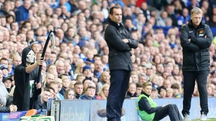 Pic of the day: The Grim Reaper lurks behind David Moyes at Goodison Park