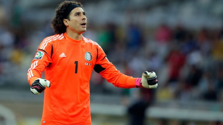 Chicago Town Take Away Slice of the Action: Mexico's Guillermo Ochoa makes a save of the tournament contender against Brazil