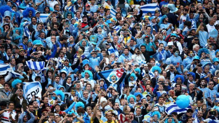Vine: Scottish fan goes absolutely nuts celebrating Suarez' second goal with Uruguay fans in Brazil