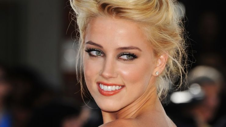 Gallery: Amber Heard, the very sexy star of action thriller 3 Days To Kill