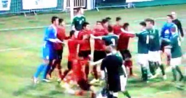 Vine: Northern Ireland player target of vicious kick to the head as violence breaks out in Milk Cup clash with Mexico