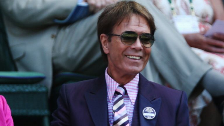 Police issue statement after officers search Cliff Richard's house in sexual abuse investigation