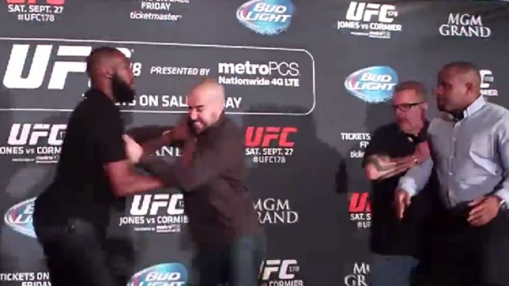 Video: Conor McGregor laughs as Jon Jones and Daniel Cormier fight at UFC 178 media day