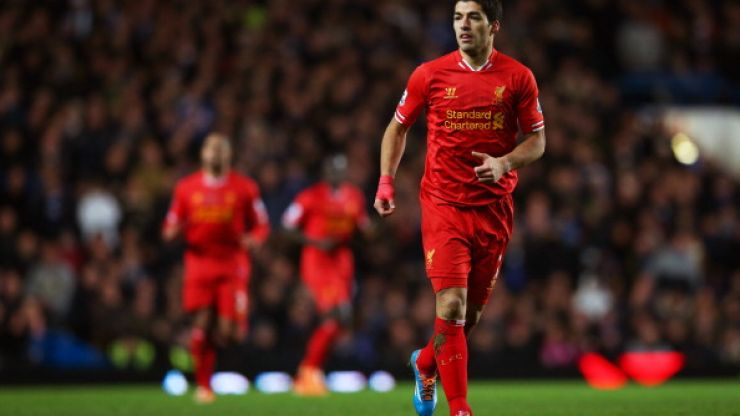 Picture: Luis Suarez stops to play football in the park with young fan who has Down Syndrome