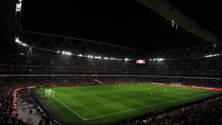 Arsenal fans shine a light on the Emirates Stadium after floodlights go out