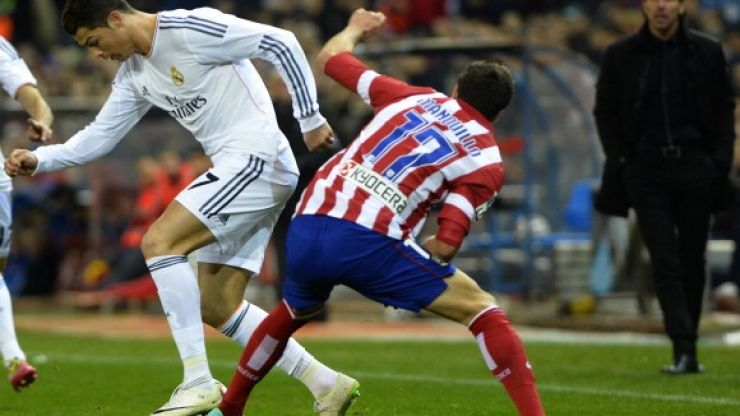 Video: Atletico Madrid's Javier Manquillo falls horribly on his neck after aerial challenge with Cristiano Ronaldo