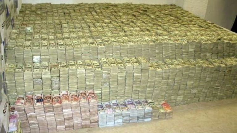 Pics: This pile of cash, worth $22bn, was found inside the insane home of a Mexican drug lord