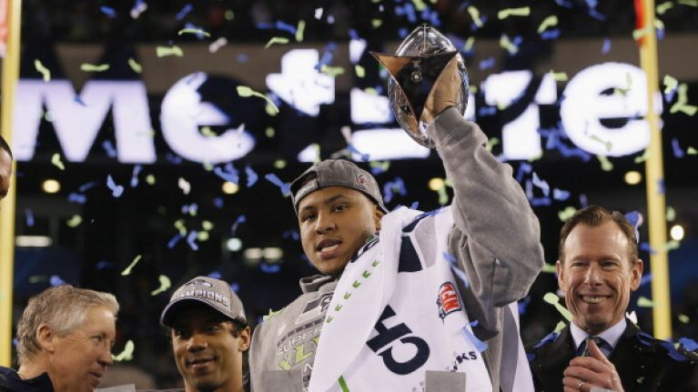 Video: Conspiracy theorist crashes Super Bowl post-game press conference