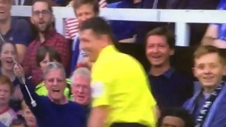 Vine: Linesman gets a helping hand from supporter at Fulham v Everton