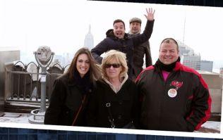 Mad Men: Jimmy Fallon and Jon Hamm brilliantly photobomb unsuspecting tourists at New York's Rockefeller Centre