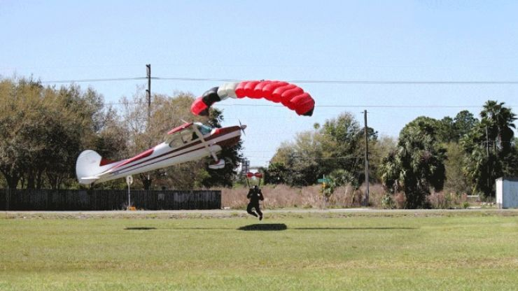 GIF: Extraordinary mid-air collision as skydiver is hit by plane and survives