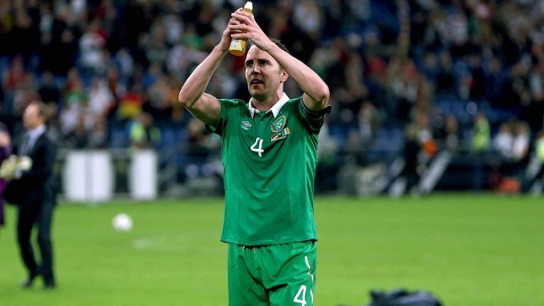 John O'Shea exits the pitch to raucous applause following his final game for Ireland