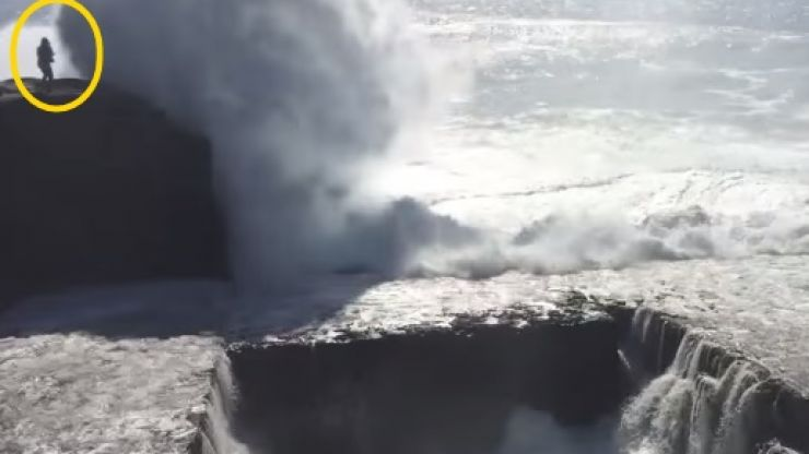 Video: Footage of a woman getting knocked off a cliff by a massive wave in Aran Islands