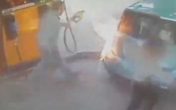 Video: Woman sets fire to a petrol pump while a man is using it in this incredible footage
