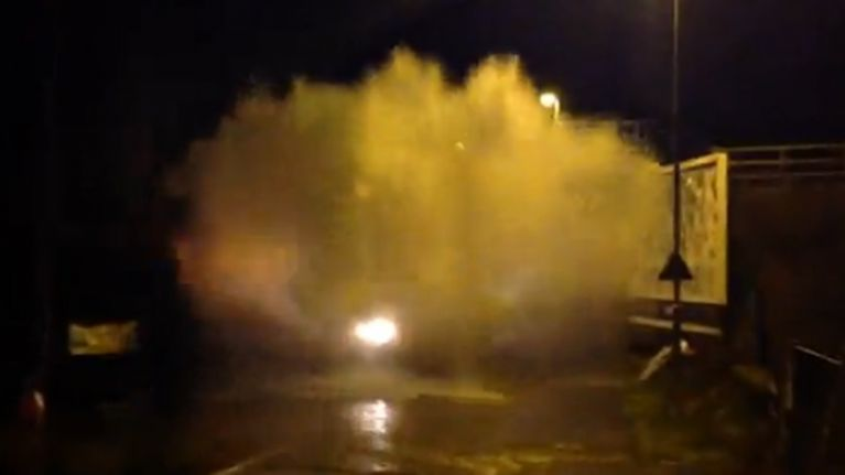 Video: Tractor creates one of the biggest splash waves you'll ever see while driving through a puddle