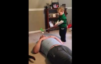 Video: Kid uses his dad's face as a golf tee, proceeds to drill him right in the head