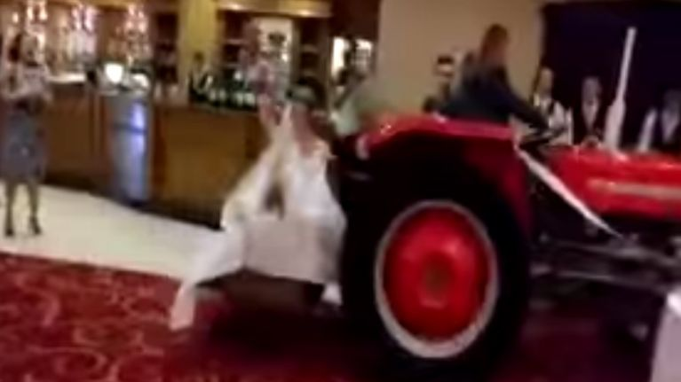 Video: Bride arrives to her wedding reception in Sligo in a transport box on the back of tractor
