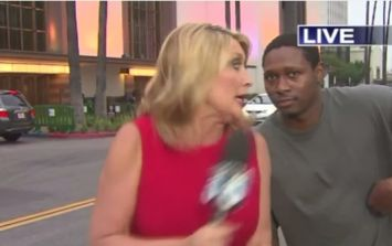 Video: This man scaring the bejesus out of a news reporter on live TV is comedy gold