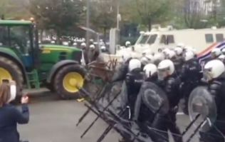 VIDEO: A water cannon completely blowing away a tractor at a protest