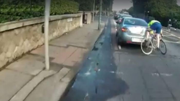 VIDEO: A cyclist in Dublin rams into the back of a car and leaves massive dent
