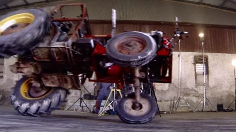 VIDEO: Guy flips a tractor trying to do a ridiculous drift in a warehouse