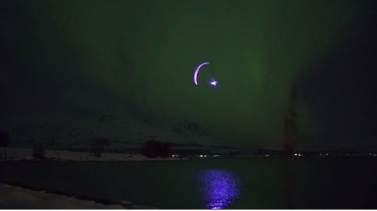 VIDEO: Absolutely amazing footage of a man paragliding around the Northern Lights