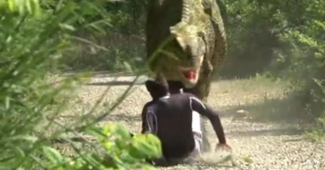 WATCH: Jogger wets himself in fear when faced with a Velociraptor in this Jurassic Prank