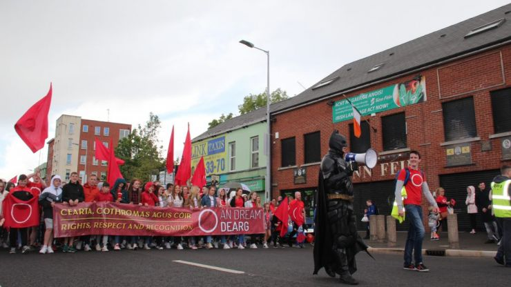 Thousands of people - including Batman - attend Irish language rally march in Belfast