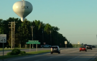 A halt in the re-painting of a water tower results in town greeting visitors with the word sex