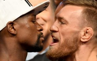 WATCH: Conor McGregor was seriously pumped up as he faced down Floyd Mayweather at the weigh-in
