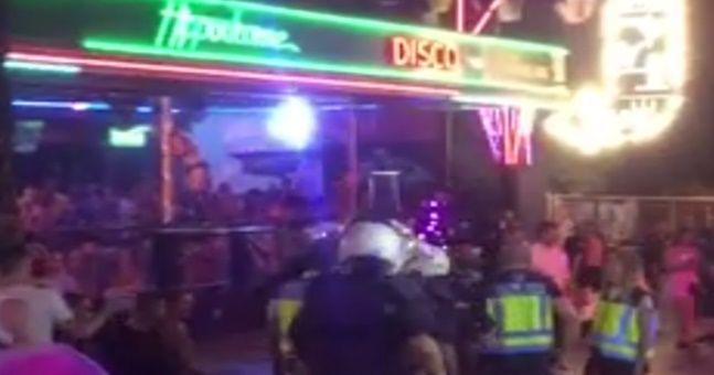 WATCH: Main strip in Benidorm on lockdown as police in riot gear raid pubs and nightclubs
