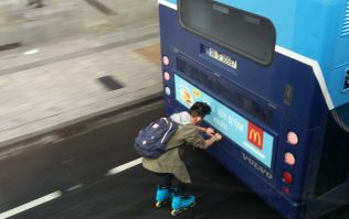 WATCH: Man on rollerblades hitches a ride down O'Connell Street on back of a Dublin Bus