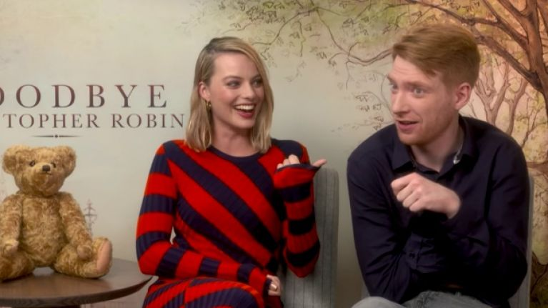 VIDEO: Margot Robbie cracks up at Domhnall Gleeson doing 'armpit farts'
