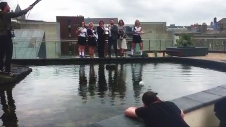 WATCH: Unsuspecting photographer gets a whack on the head during camogie launch