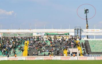 Football fan receives stadium ban, so he hired a crane to watch the game from