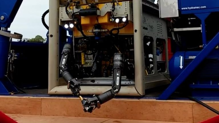 WATCH: Robot in Limerick launches itself with a bottle of champagne and it's mildly terrifying