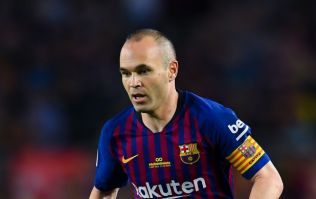 PICS: Andres Iniesta sits alone on the Camp Nou pitch at 1am, following his last game for Barcelona