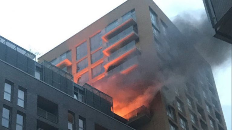 Sixty firefighters battle blaze at high-rise tower block in south London