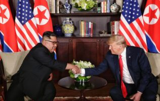 "Donald Trump and Kim Jong-un sign ""comprehensive agreement"" in historic meeting"