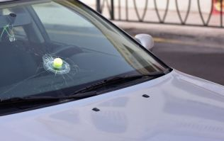 Man's car almost hit by golf ball on Irish road where there is no golf course... or driving range