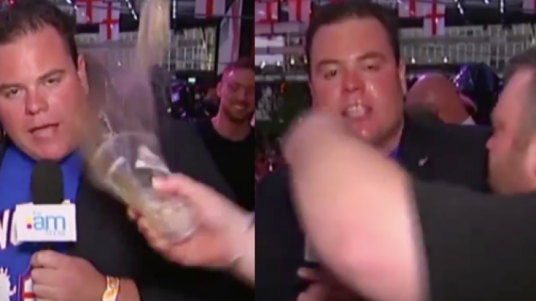 TV reporter gets beer thrown in his face during a very volatile report on the England match