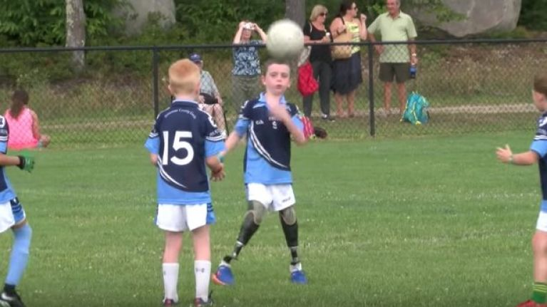 WATCH: Amazing eight-year-old boy is the star of his Gaelic football team after losing both of his legs